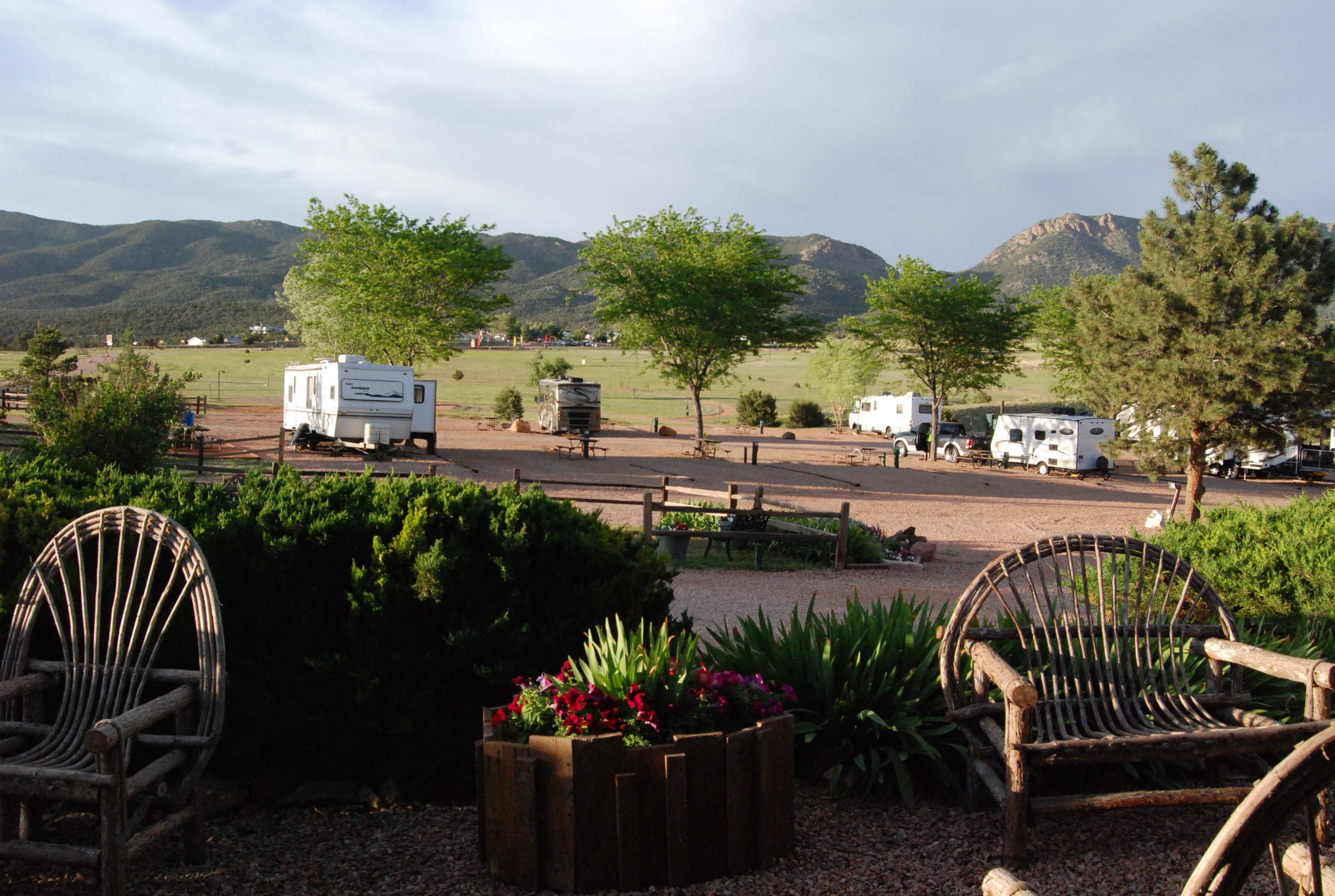 View of the RV sites with trees and blue sky.